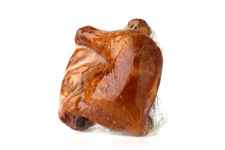 Smoked chicken legs in vacuum-packed. Two chicken legs close up on a white background.