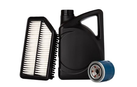 Oil canister and filters on white background. Car filters and oil in canister close-up.