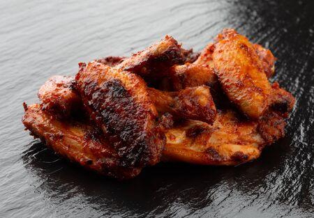 Fried wings close-up. Buffalo wings on a slate surface.