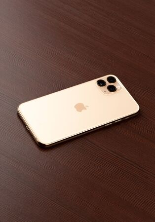 Rostov-on-Don, Russia - october 2019. Apple iPhone 11 Pro on a wooden surface.  New smartphone from the company Apple close-up.