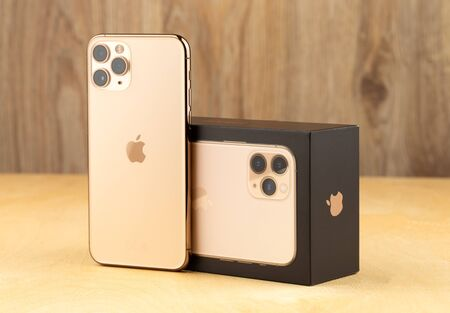 Rostov-on-Don, Russia - october 2019. Apple iPhone 11 Pro on a wooden surface.  New smartphone from the company Apple close-up. Smartphone and box from it.