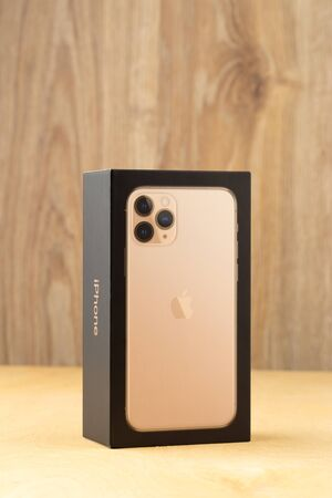 Rostov-on-Don, Russia - october 2019. Apple iPhone 11 Pro on a wooden surface. Apples new smartphone in a box close-up.