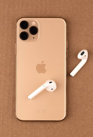 Rostov-on-Don, Russia - october 2019. Apple iPhone 11 Pro on a cardboard surface. Apples new smartphone close-up. Smartphone and AirPods earphones.