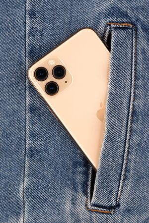 Rostov-on-Don, Russia - october 2019. Apple iPhone 11 Pro in jeans pocket. New smartphone from the company Apple close-up. Redactioneel