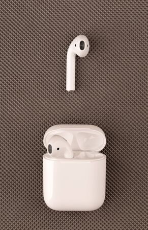 Rostov-on-Don, Russia - october 2019. Apple Airpods on a gray surface. Wireless headphones close-up. Redactioneel