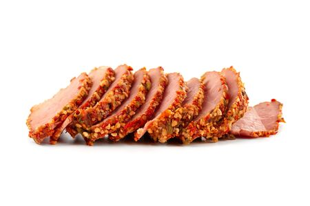 Slices of smoked beef in spices close-up. Smoked tenderloin cut into slices close-up. Stockfoto