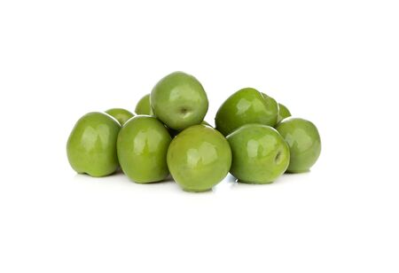 Pickled olives on a white background. Bunch of pickled green olives isolated on white background.