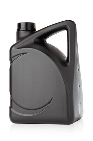 Canister for technical liquids on a white background. Black Canister for automotive oil close-up.