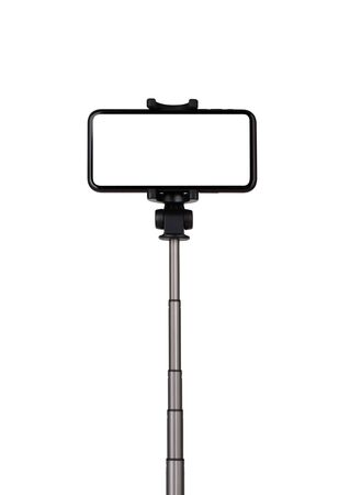 Smartphone with a white cut-out screen on a monopod. Selfie stick and smartphone on a white background.