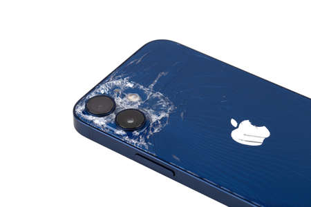 Rostov-on-Don, Russia - February 2021. iPhone 12 in blue on a white background. Close-up of a smartphone with a broken body.