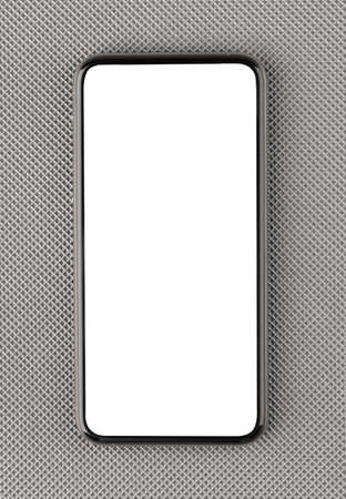 Smartphone with a blank white screen. New popular smartphone on a gray surface.