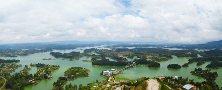 The Lake Of Guatape Seen From The Top Of The El Penon in Colombia 写真素材 - 102525263