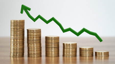 Stacks of coins in a growth real estate concepts.