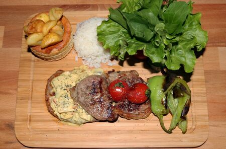 Portion of Delicious Grilled Meat With Rice and Vegetables
