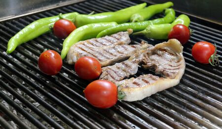 Beef Steaks on the Grill with Vegetables Stockfoto