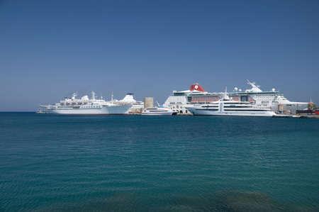 Sea cruise ships near pier in Rhodos harbor photo