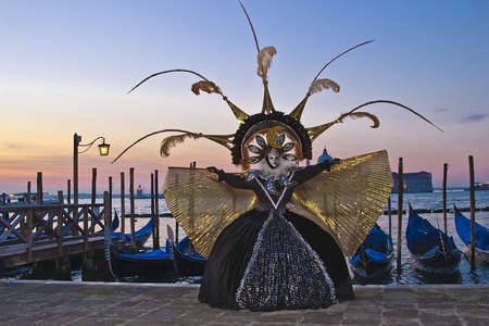 magnificence: Flamboyant costume at the Venice sunrise Stock Photo