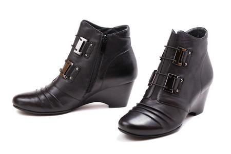 Stylish female boots of black colour of graceful modern design. Stock Photo - 8275639