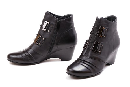 Stylish female boots of black colour of graceful modern design. Stock Photo - 8275639