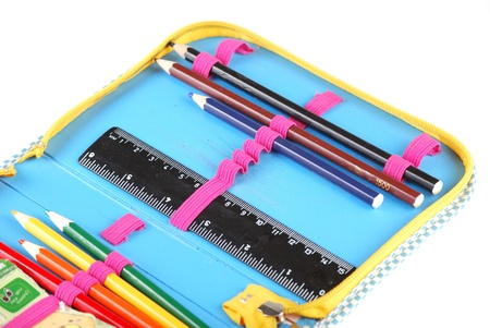 School case with a set of handles of pencils and a black ruler. photo