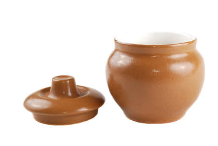 Brown pot for cooking with a cover Stock Photo - 8276213