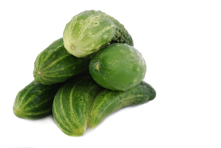 Green ripe cucumbers on a white background Stock Photo - 8809701