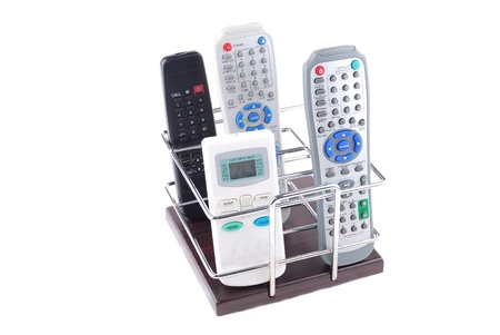 remote controls: Support under mobile phones and remote controls on a white background