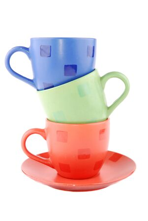 Multi-coloured cups on a support on a white background photo