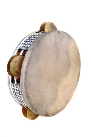 Tambourine with the tense skin and the inlaid rim with sonorous plates photo