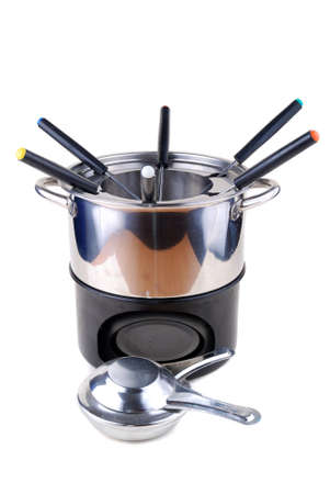 Fondue for use at cheese or chocolate heating photo