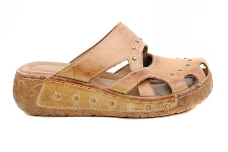 Barefoot persons from a brown skin on a thick corrugated sole photo