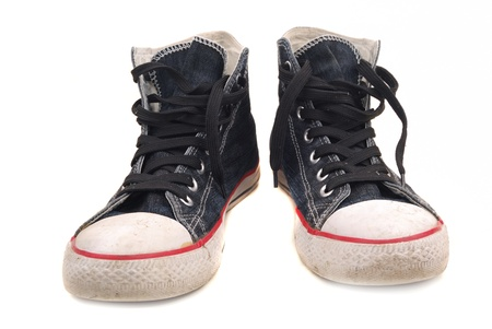 Old gym shoes on a thin white sole for playing sports and tourism Stock Photo - 9210376