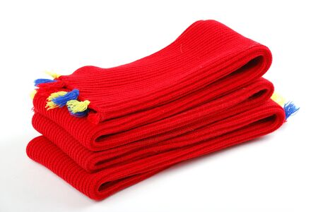 muffle: Scarf. A winter warm red scarf with colour brushes.  Stock Photo