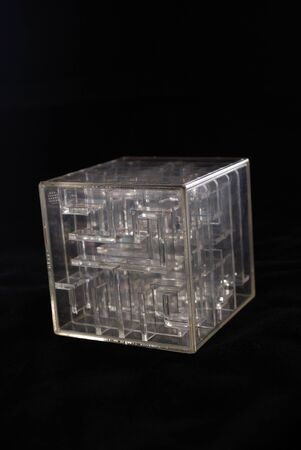 boxs: Labyrinth in a transparent cube on a black background Stock Photo