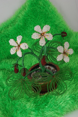 Tree from beads in a pot on a dark background photo