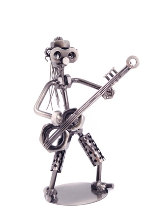 The robot collected from nuts and bolts welded among themselves on a white background Stock Photo - 11395839