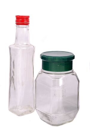 Empty glass bottle with a stopper on a white background photo