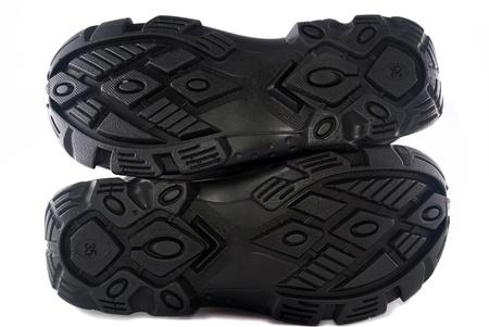 sole of hiking shoes isolated on white background photo