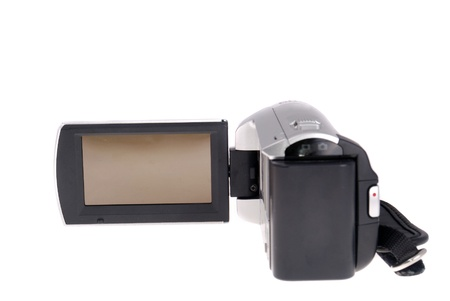 Videocamera with the developed screen on a white background photo