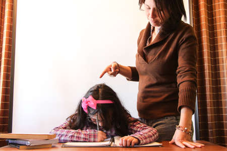 scold: mother scolding her daughter to study
