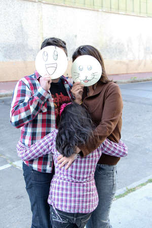Family hug with masks photo