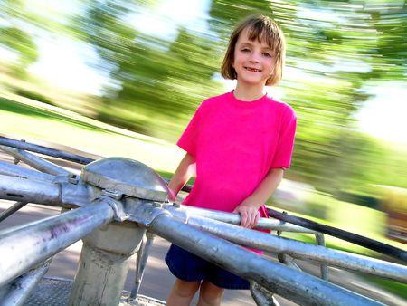 Little Girl on Spinning Merri-Go-Round Banco de Imagens