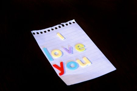 Love note with letters on paper