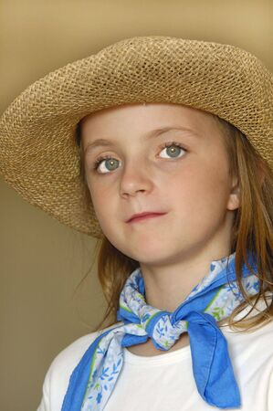 Little girl wearing straw hat with big eyes photo