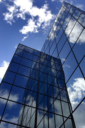 Office building reflecting sky and clouds photo