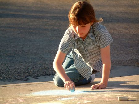 ittle: ittle girl drawing on sidewalk with chalk Stock Photo