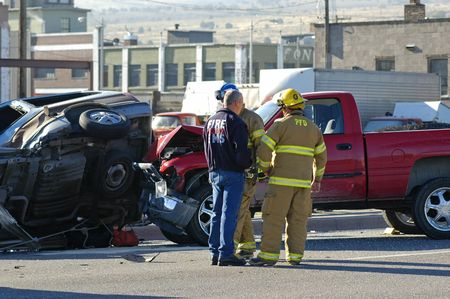 Car accident with emergency people investigating the scene