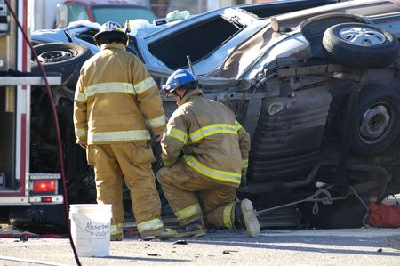 Car accident with emergency people investigating the scene photo