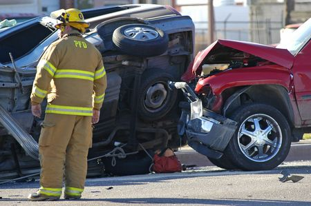 Car accident with emergency people investigating the scene Stock Photo - 585565