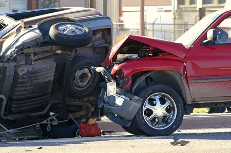 Two cars smashed together in a car accident with rollover Stock Photo - 585566